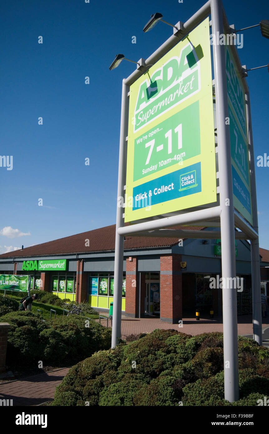 asda convenience store stores ahop shops food retail retailer local small open 7 until 11sign converted netto branch - Stock Image