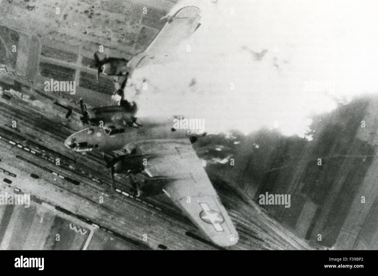 BOEING B-17 FLYING FORTRESS is shot down during a raid over Germany Stock Photo