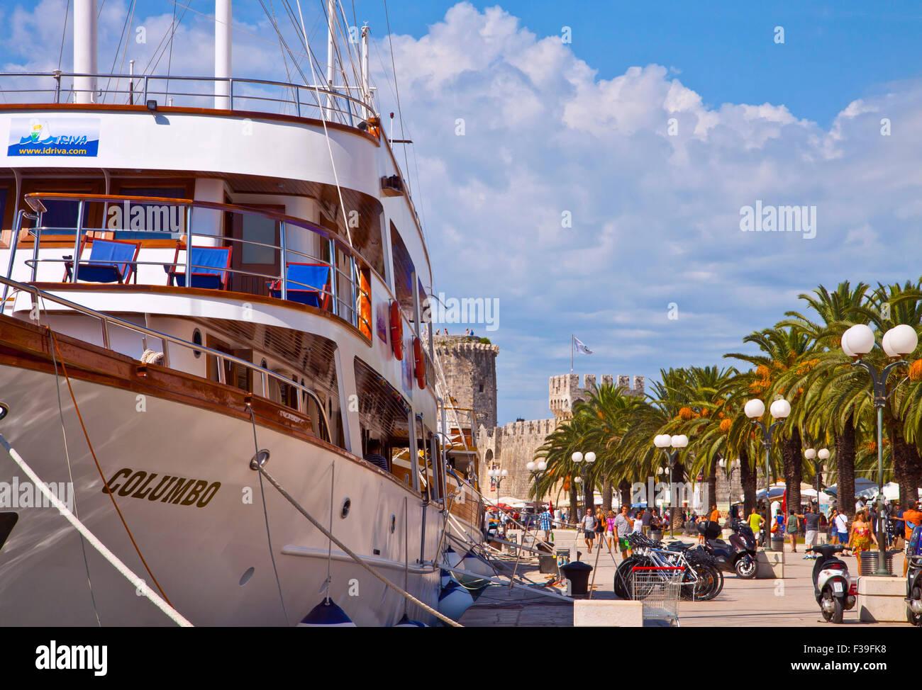 Trogir Croatia sea promenade with cruise ship and medieval  Kamerlengo castle Stock Photo