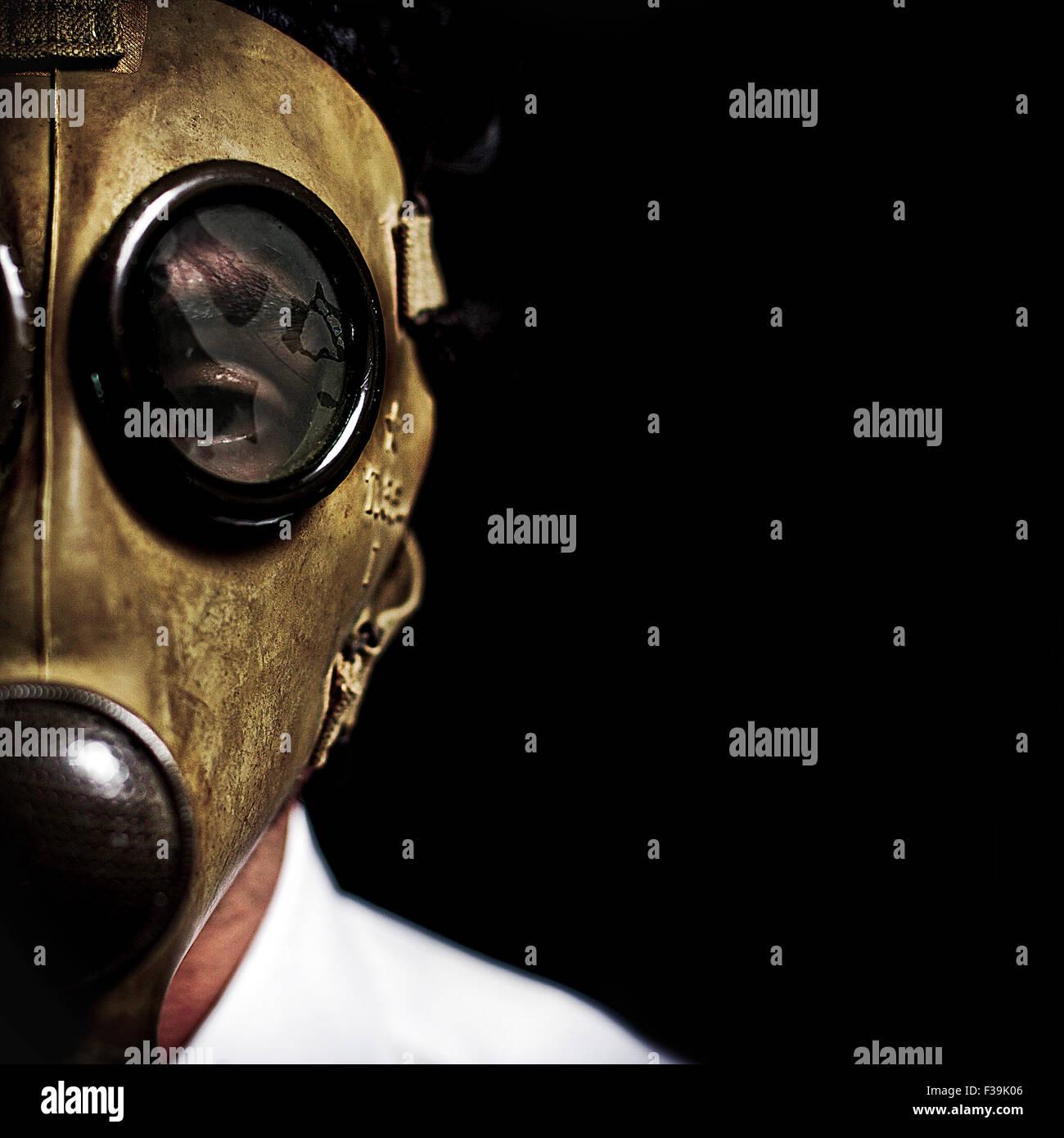 Man wearing a gas mask - Stock Image