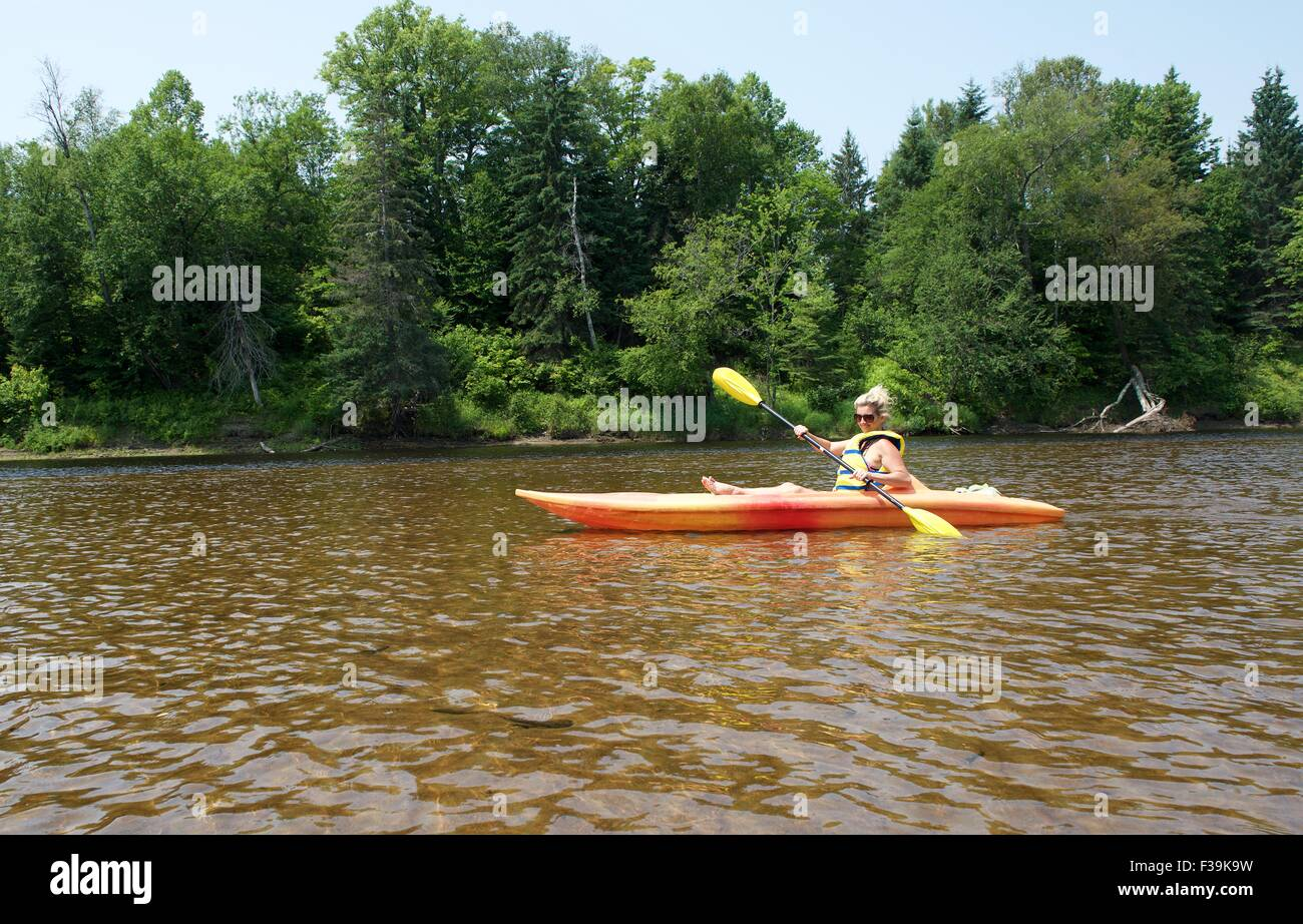 Woman kayaking in the river, Mont Tremblant, Canada - Stock Image