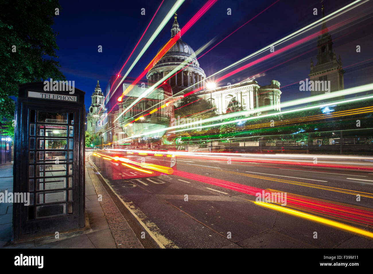 Light trails in front of St Paul's Cathedral, London, England, UK - Stock Image