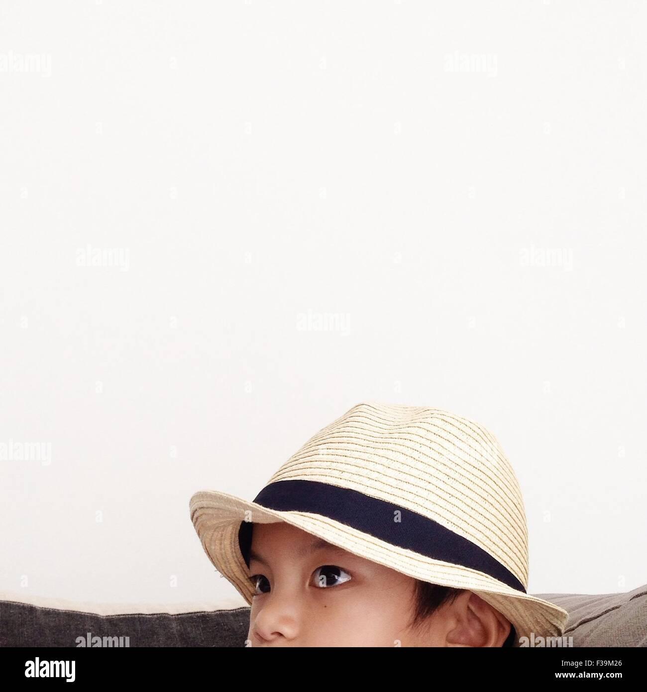 Portrait of a boy wearing straw hat - Stock Image