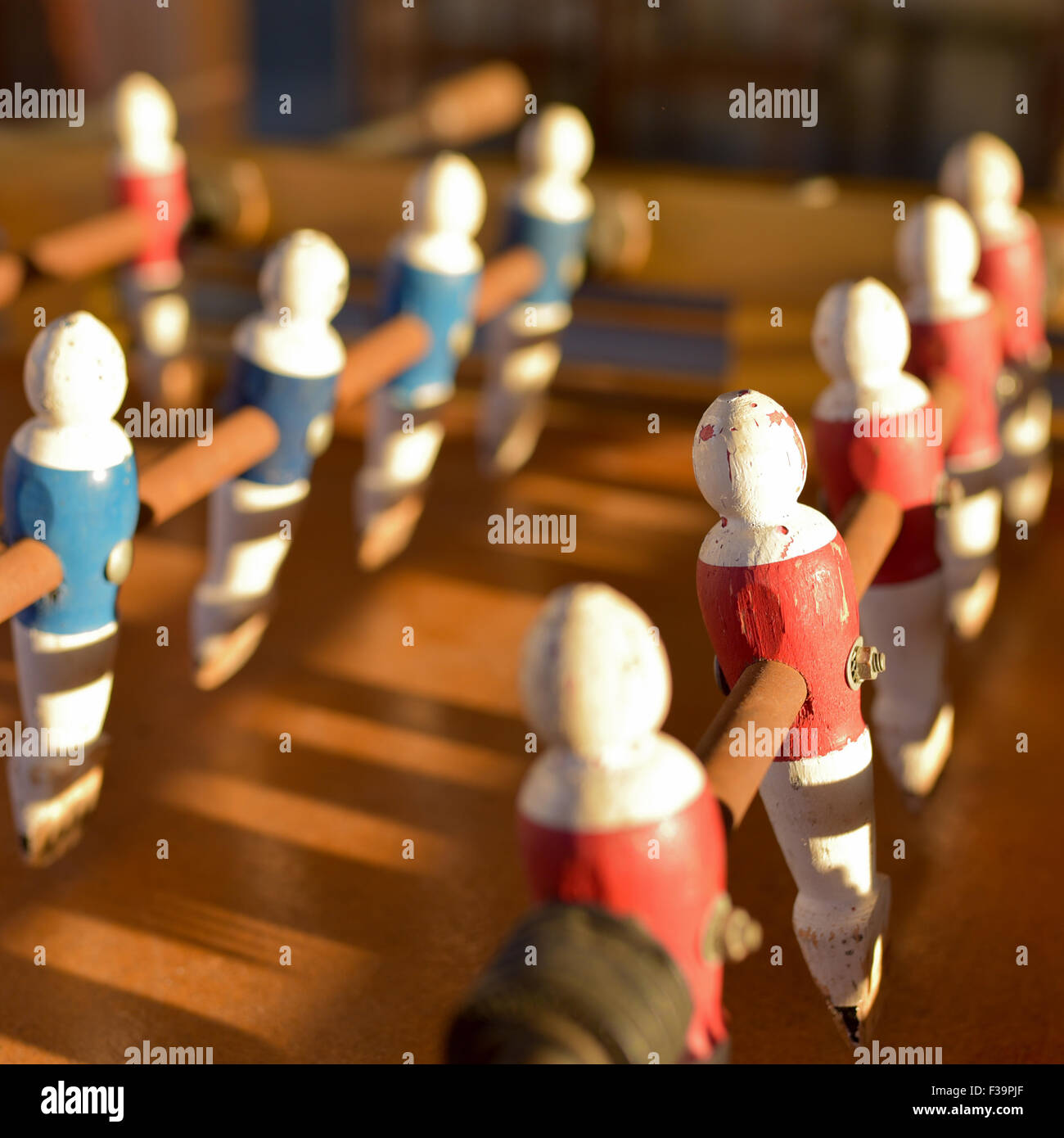Wooden table football in a sunrise. Closeup. Greece. - Stock Image