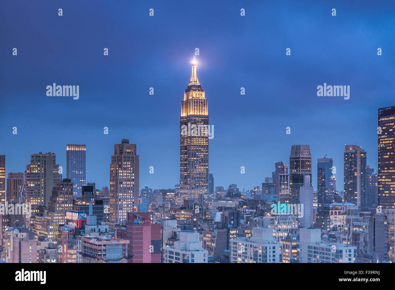View of The Empire State Building at dusk from 42th avenue in Manhattan. Stock Photo