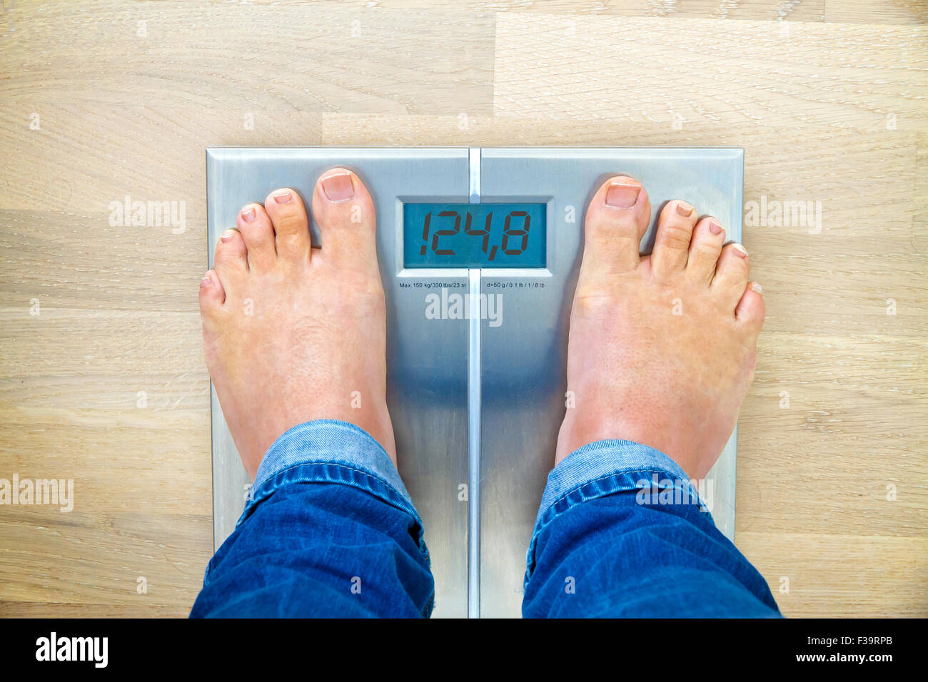 Man Standing On Weight Scales With Bare Foot View From Top