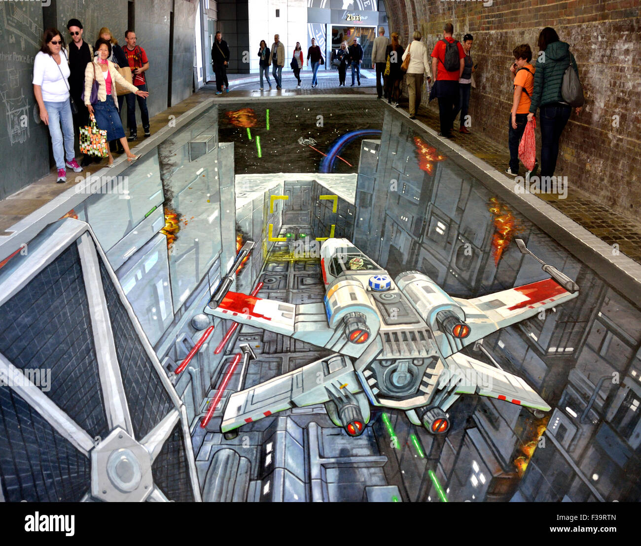 London, UK. 2nd October, 2015. 3D pavement art, created by 3D artists Joe and Max, depicting a scene from 'Star - Stock Image