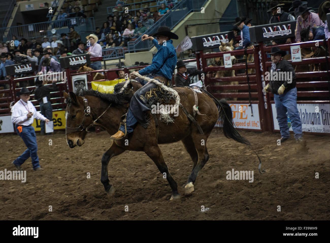 Cowboy Riding Bucking Horse During Rodeo In Oklahoma City Oklahoma Stock Photo Alamy