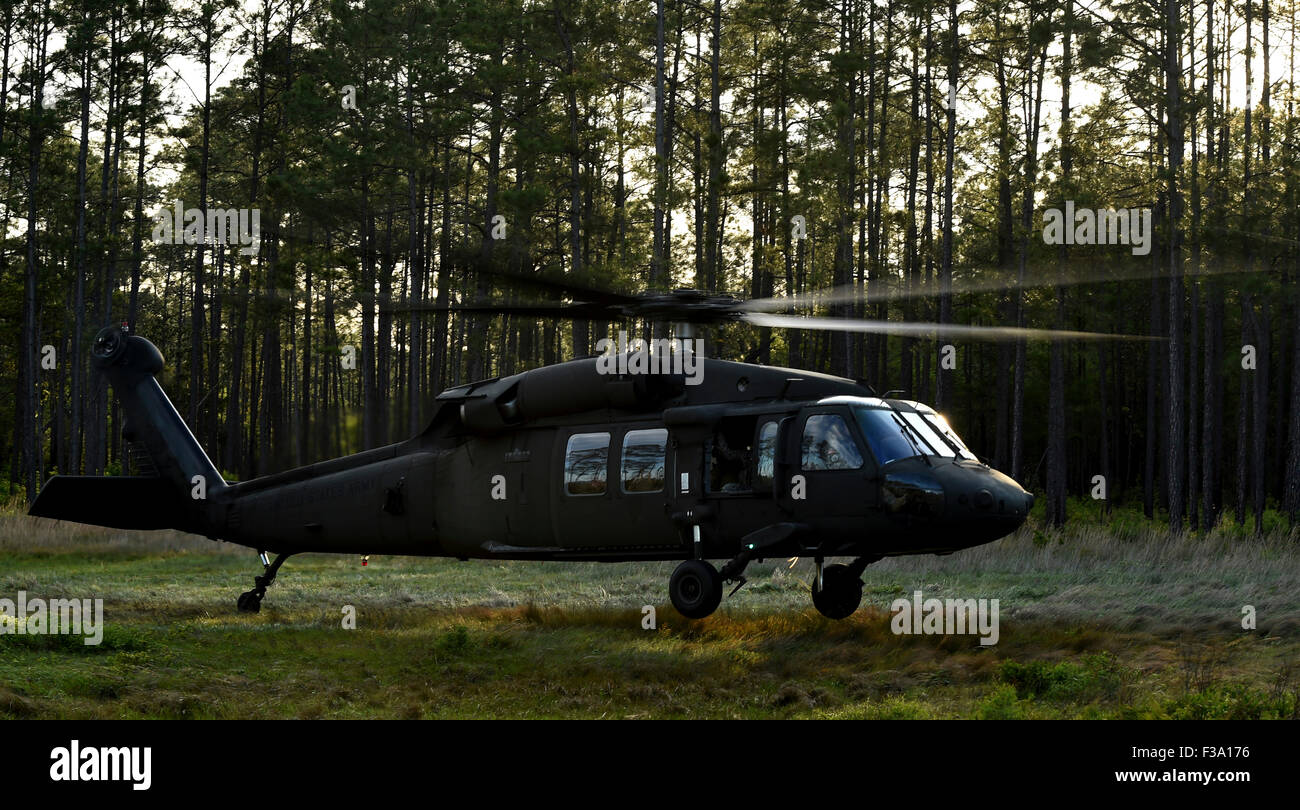 April 22, 2015 - An HH-60 Pave Hawk evacuates injured patients during a medical bilateral casualty evacuation during - Stock Image