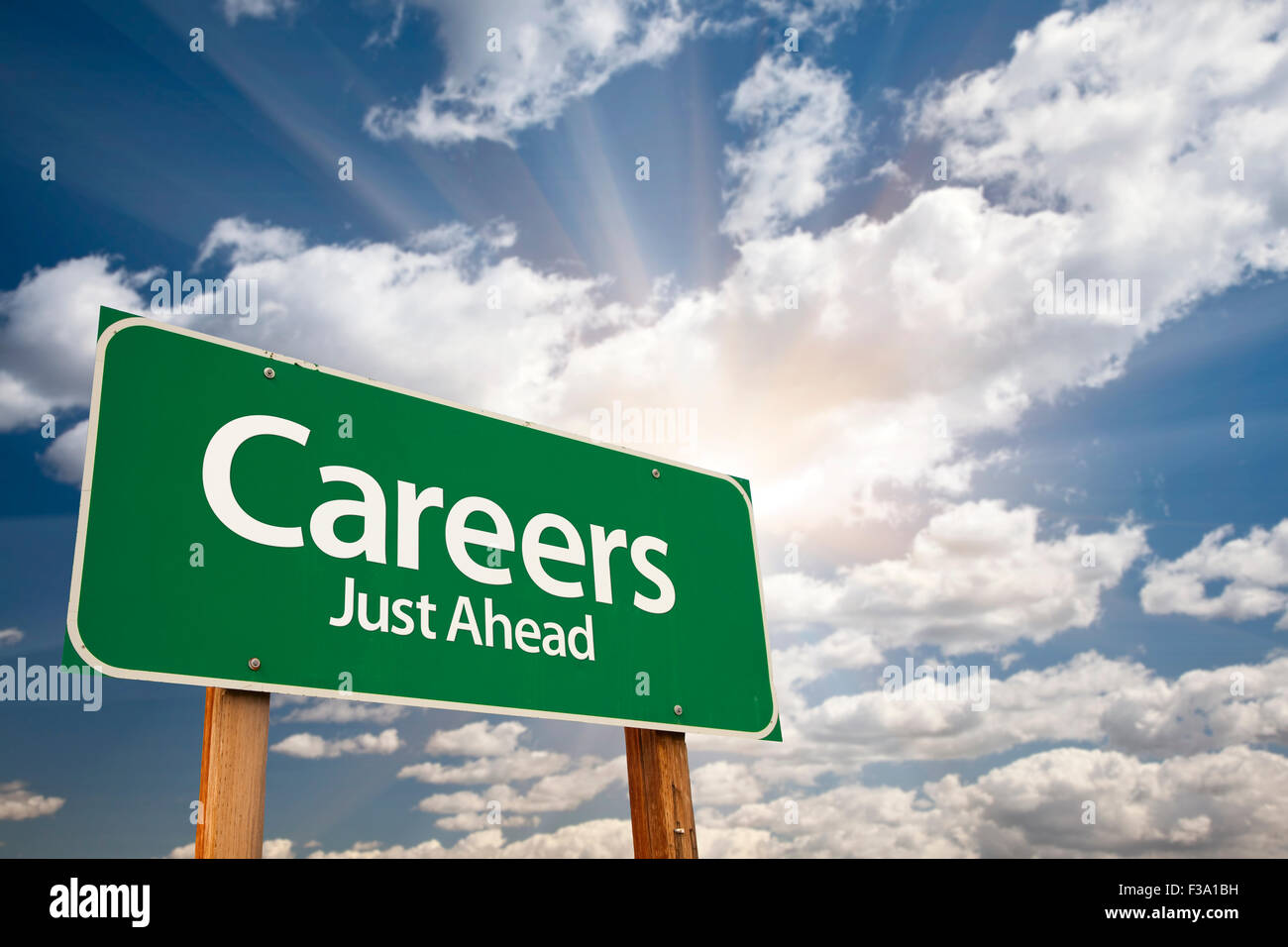 Careers Green Road Sign With Dramatic Clouds and Sky. - Stock Image