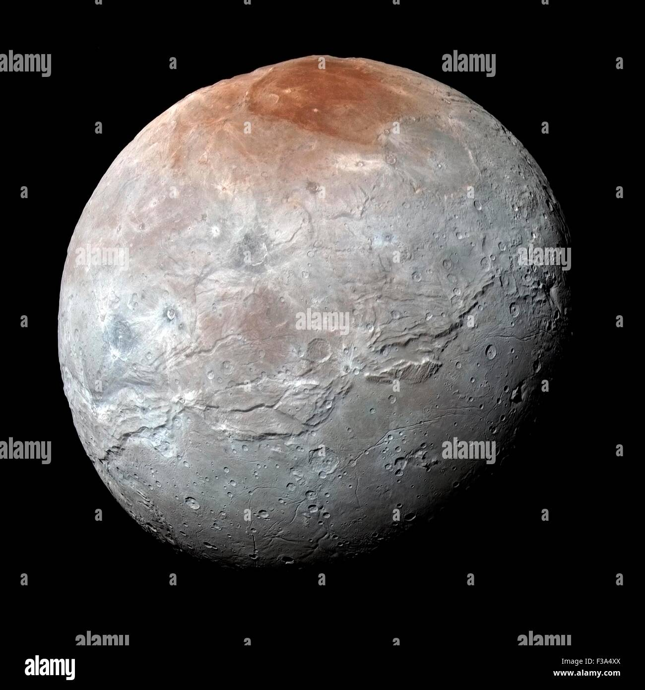 Pluto. 2nd October, 2015. Giant chasms appear on the surface of Charon, the biggest moon around the dwarf planet Stock Photo
