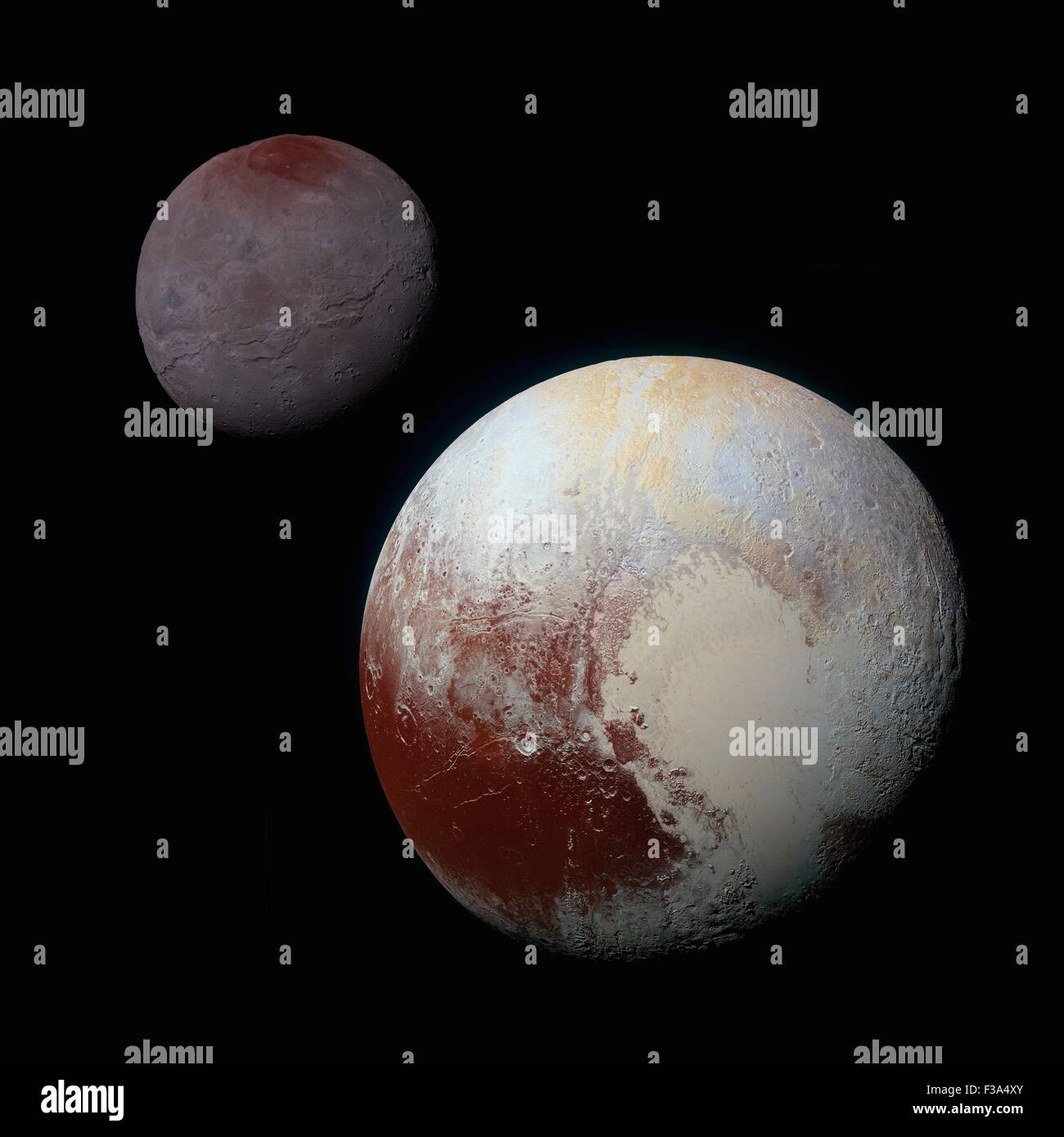 Pluto. 2nd October, 2015. A composite of enhanced color images showing Pluto on the bottom right and Charon, the - Stock Image