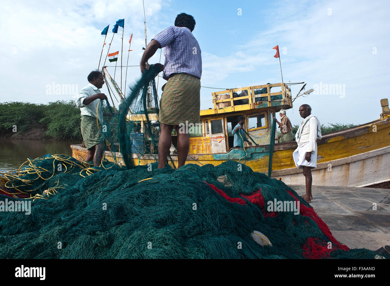 Fishermen back from fishing ( India) - Stock Image