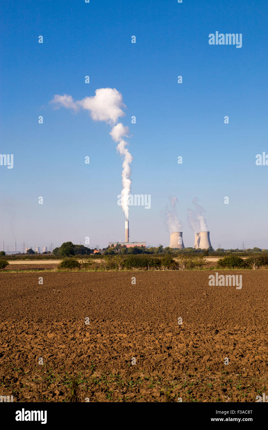 Cottam power station in England.  Cooling towers with smoke coming from cooling towers - Stock Image
