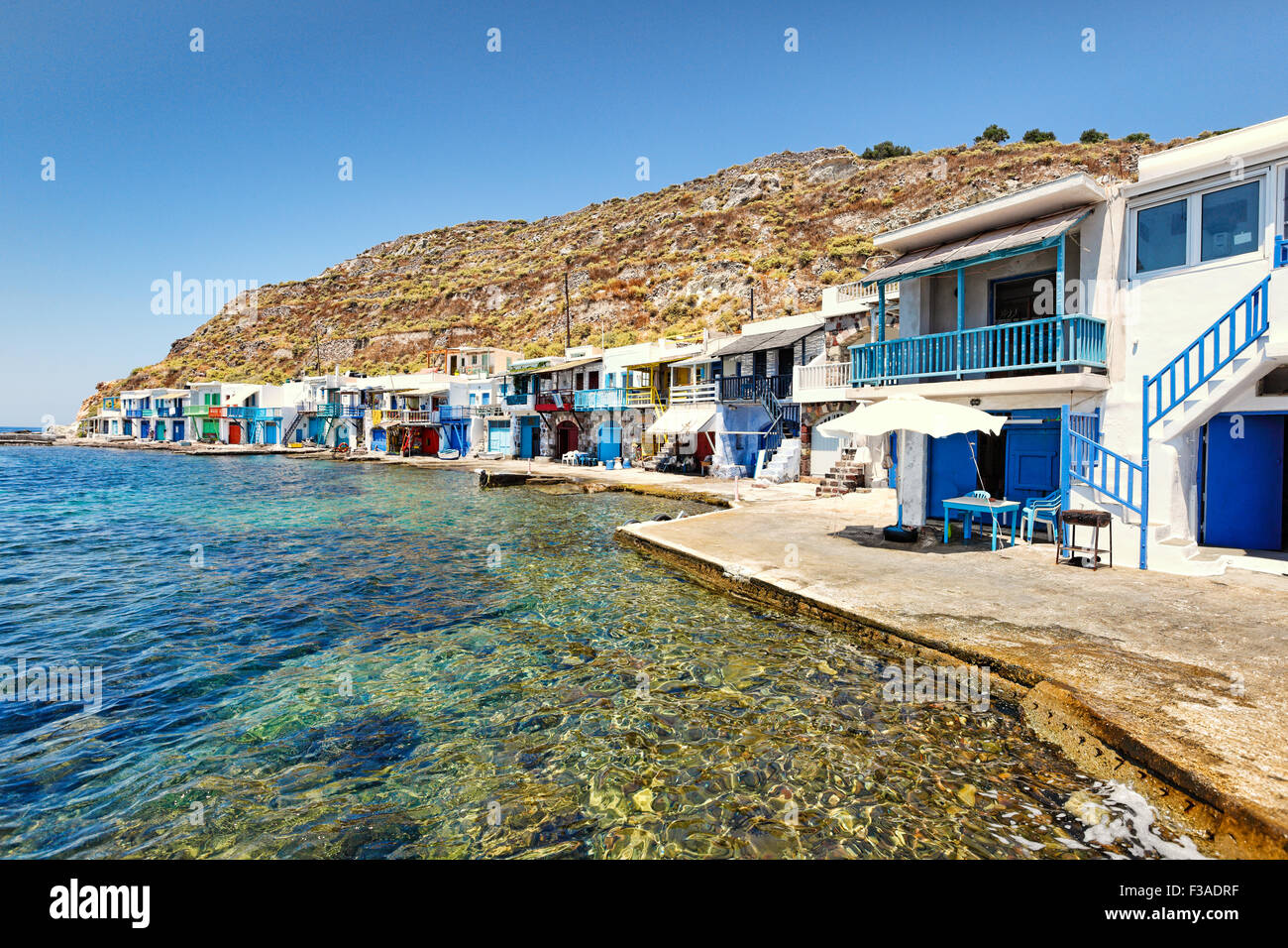 """Traditional fishermen houses with the impressive boat shelters, also known as """"syrmata"""" in Klima of Milos, Greece - Stock Image"""