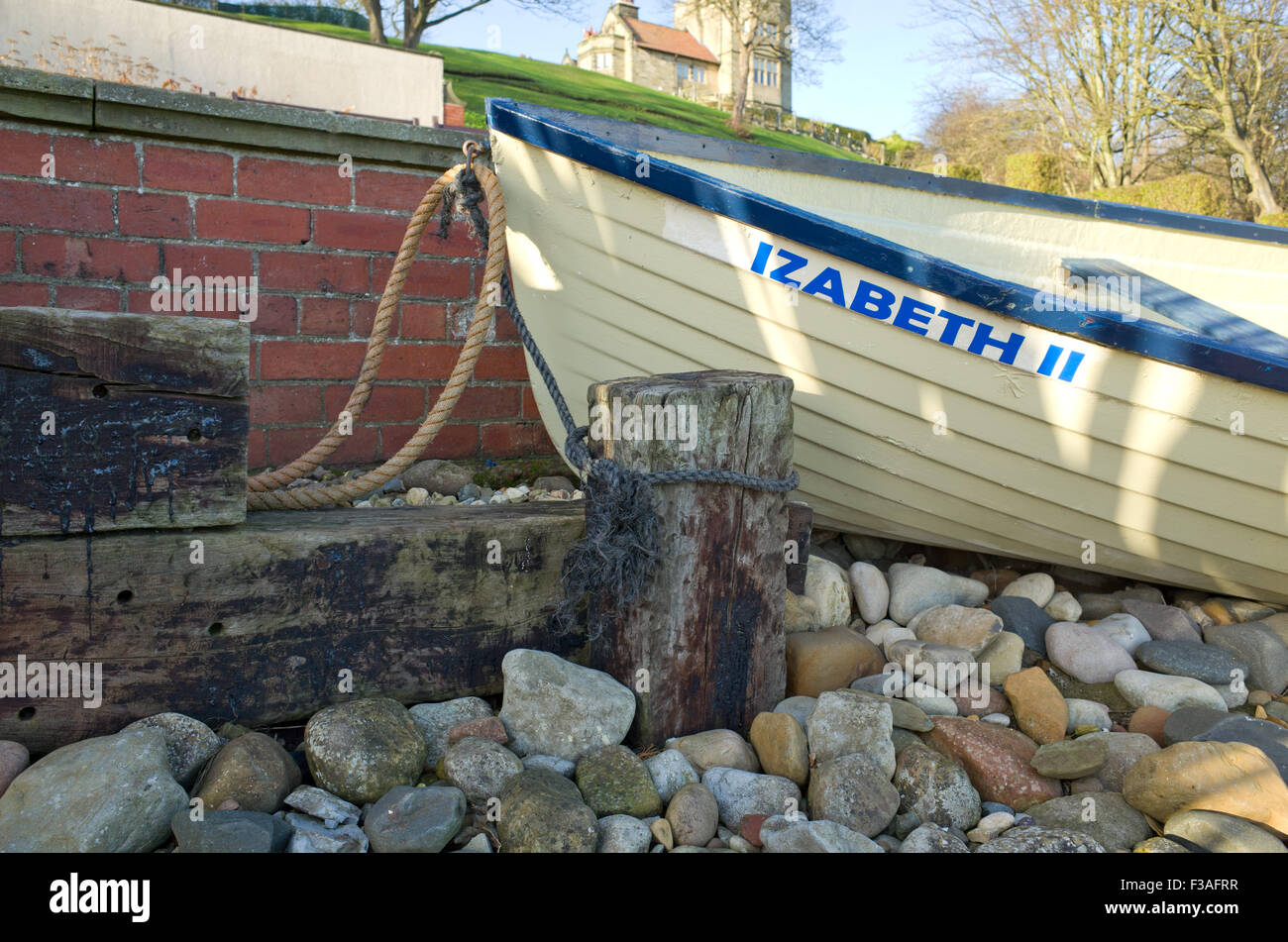 Old rowing boat park display, Filey North Yorkshire UK Stock Photo