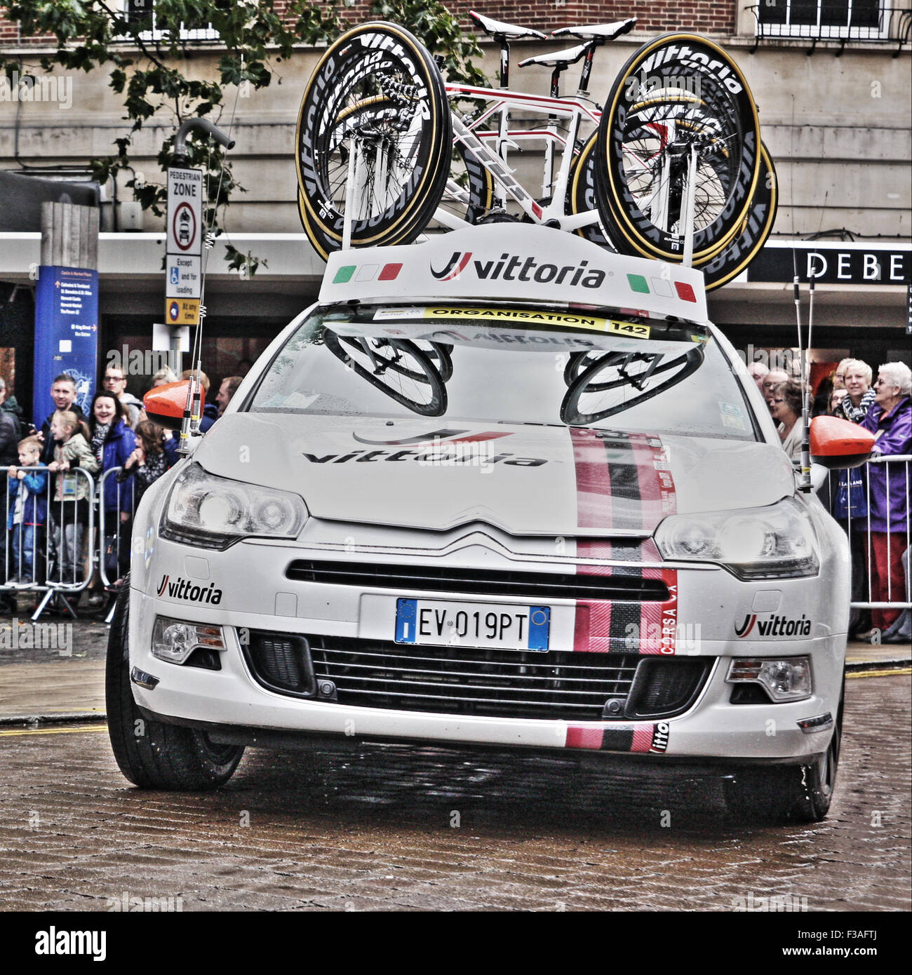 Team car driving through Norwich on the Tour of Britian - Stock Image