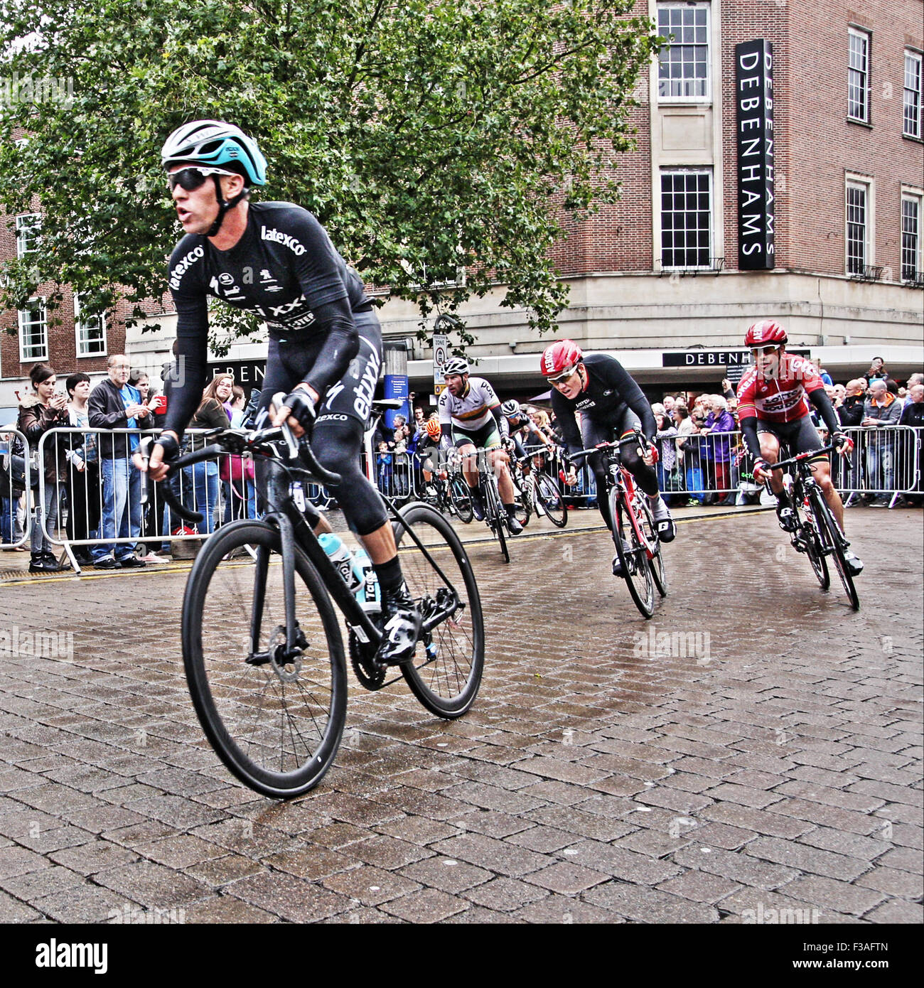 Cyclists on Tour of Britian cycle race through Norwich - Stock Image