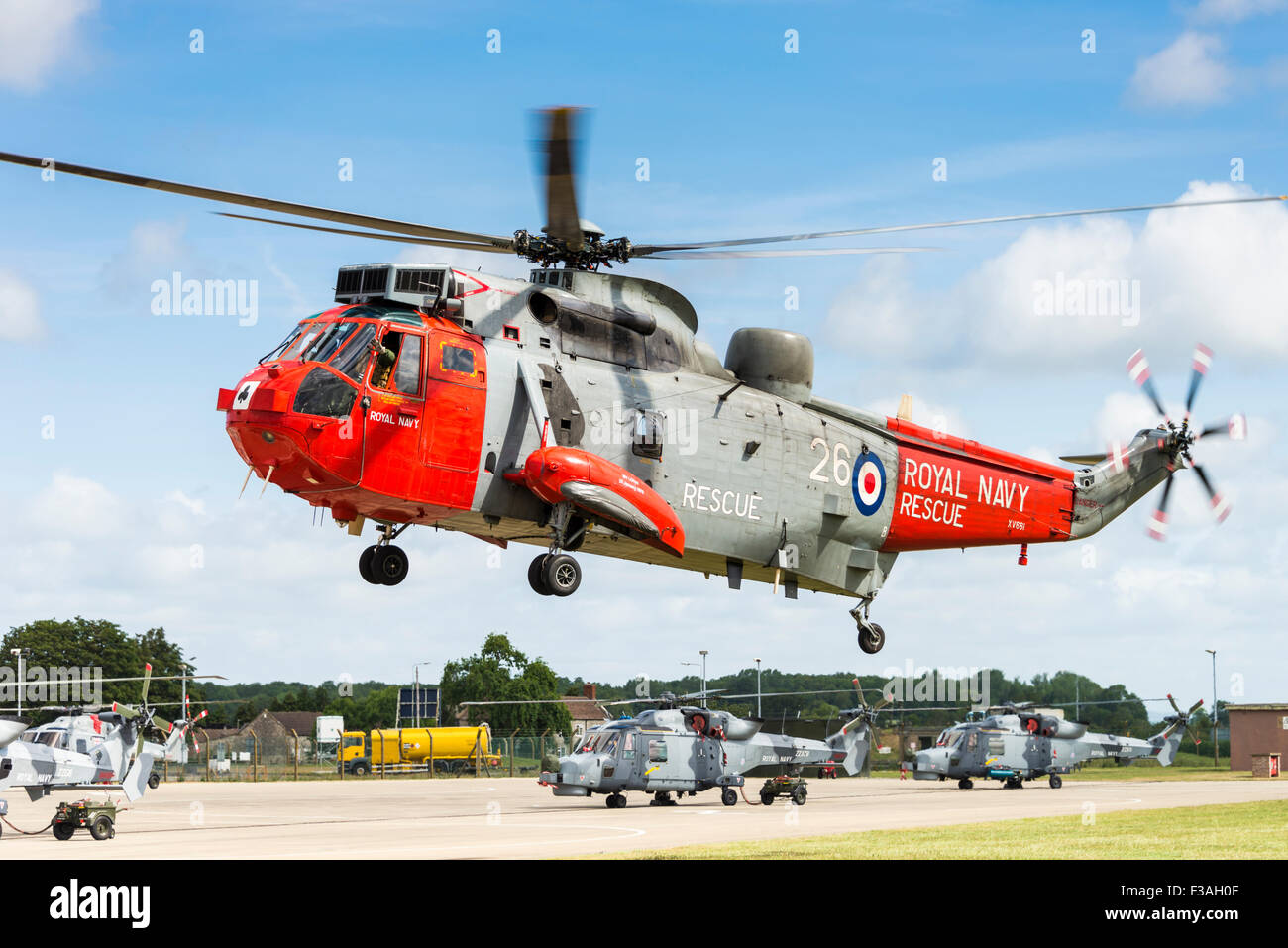 Royal Navy Westland Sea King HU5 search and rescue helicopter hovering - Stock Image