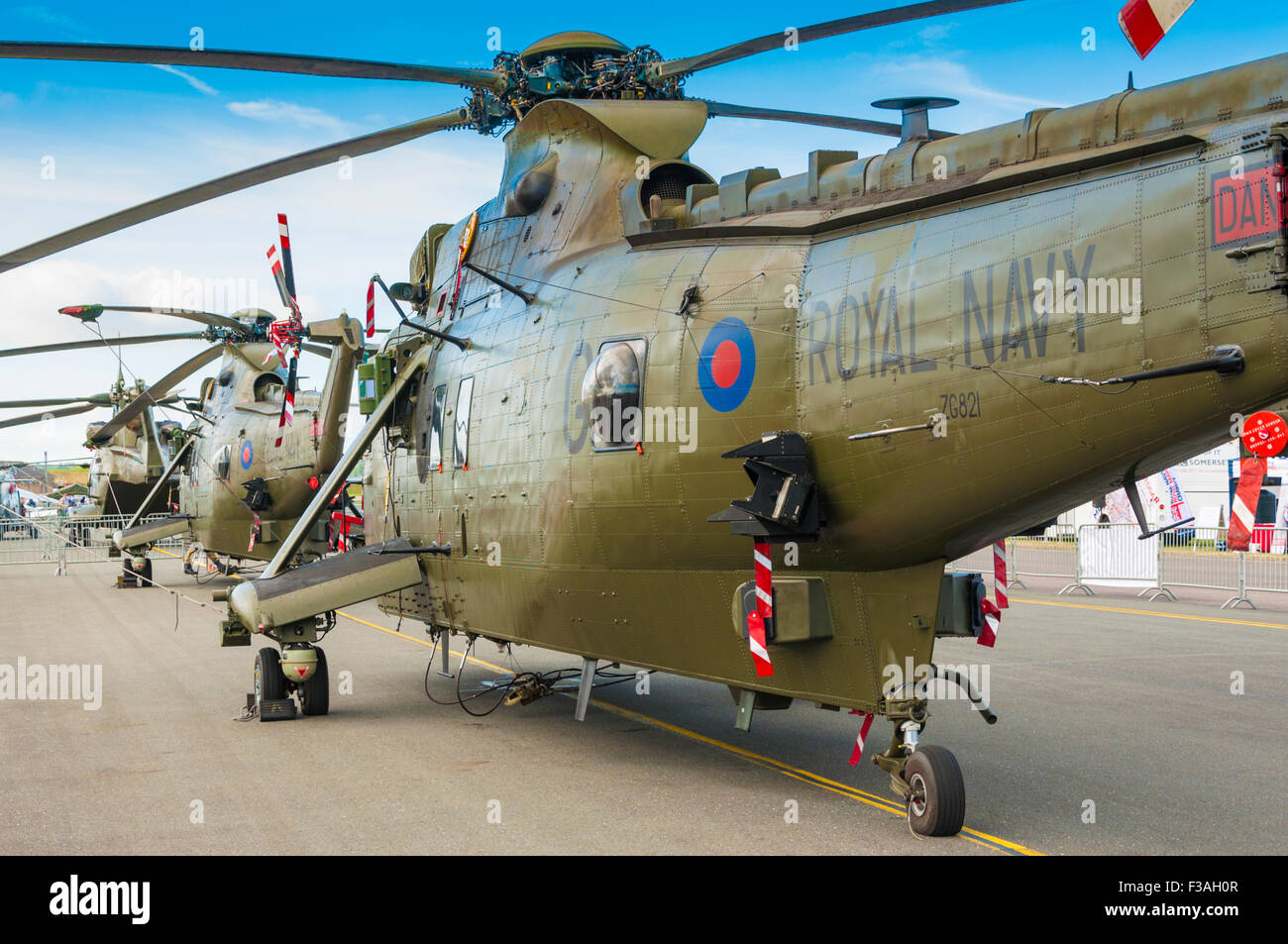 A line of Westland Sea King HC4 ('Westland Commando') helicopters on static display - Stock Image