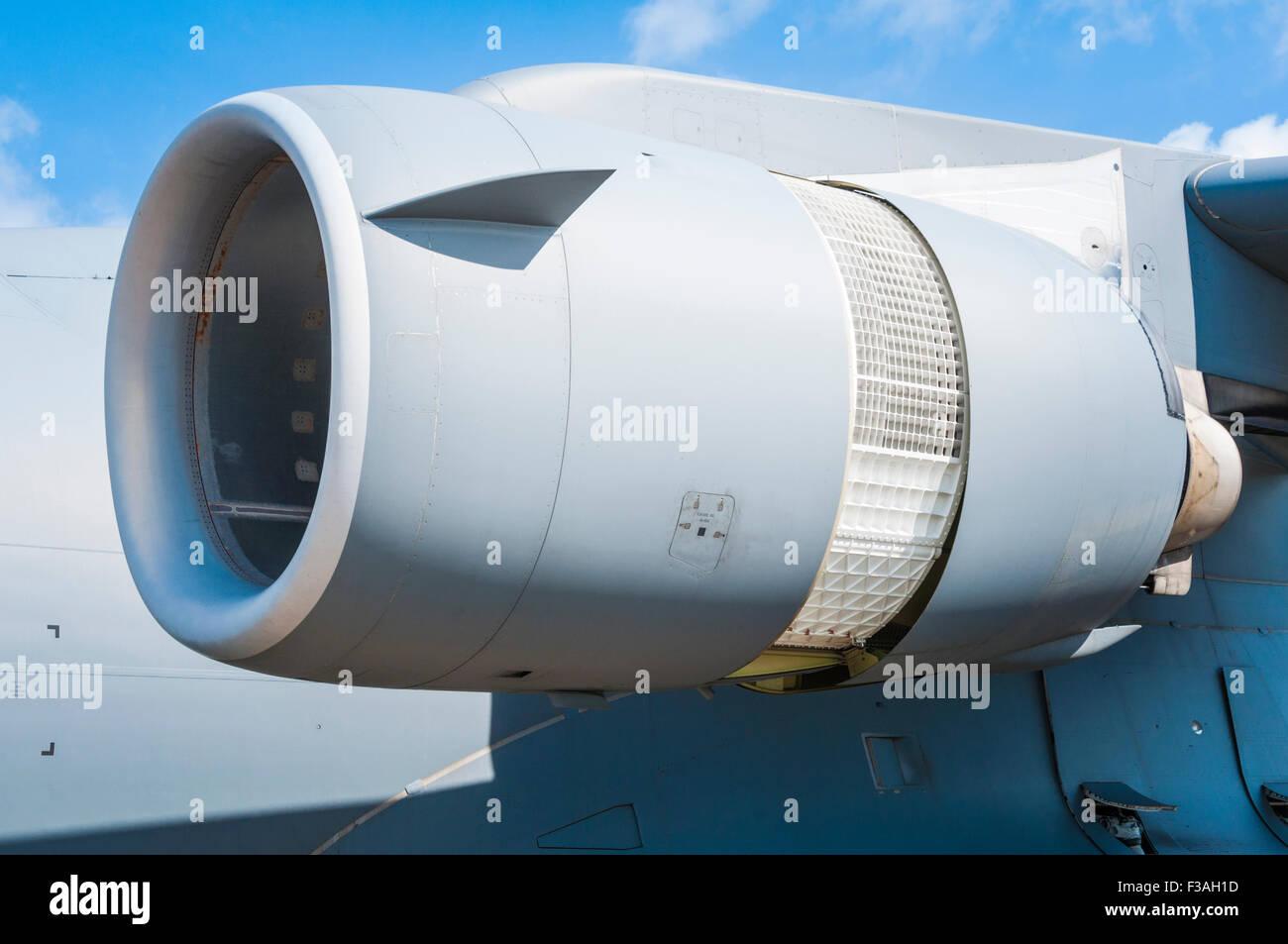 The port inner engine of a McDonnell Douglas/Boeing C-17 Globemaster III configured for reverse thrust - Stock Image