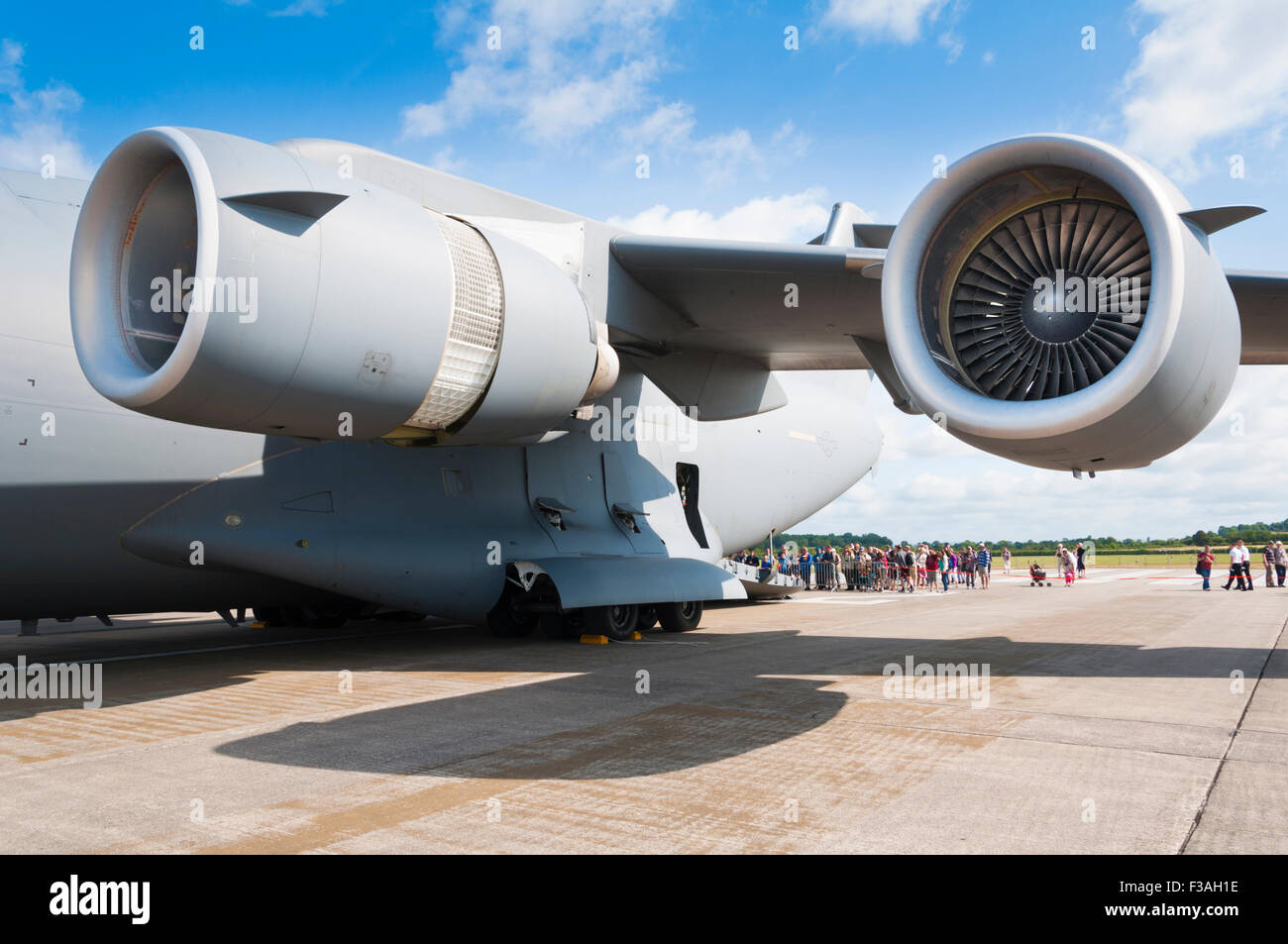 The two port engines of a McDonnell Douglas/Boeing C-17 Globemaster III with the inner engine configured for reverse - Stock Image