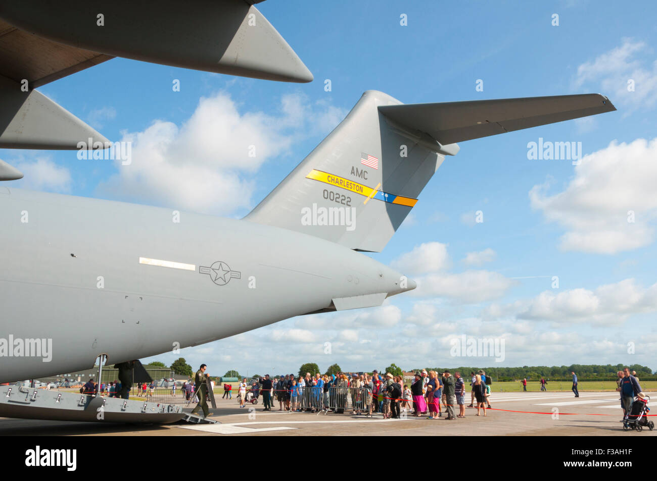 The tail of a McDonnell Douglas/Boeing C-17 Globemaster III towers above spectators at RNAS Yeovilton Air Day 2015 - Stock Image