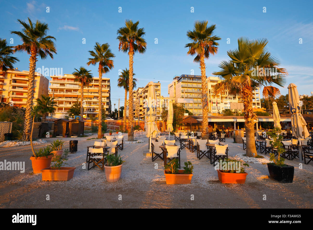 Umbrellas and tables on the beach in Palaio Faliro in Athens, Greece - Stock Image