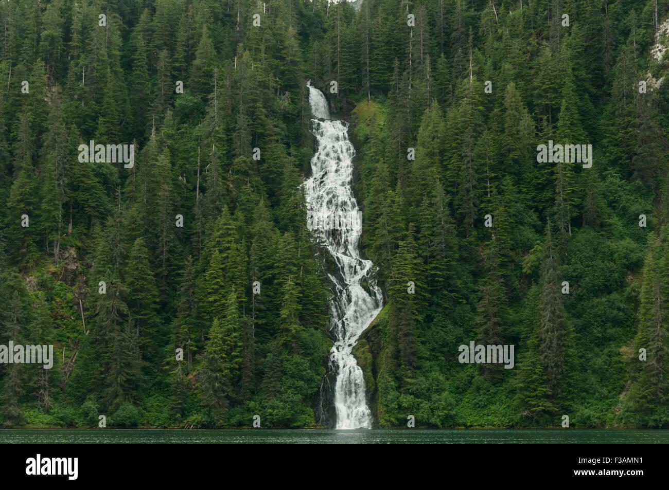 Waterfalls are plentiful in Southeast Alaska. This hugh cascade tumbles into Red Bluff Bay, Baranof Island, Tongass - Stock Image