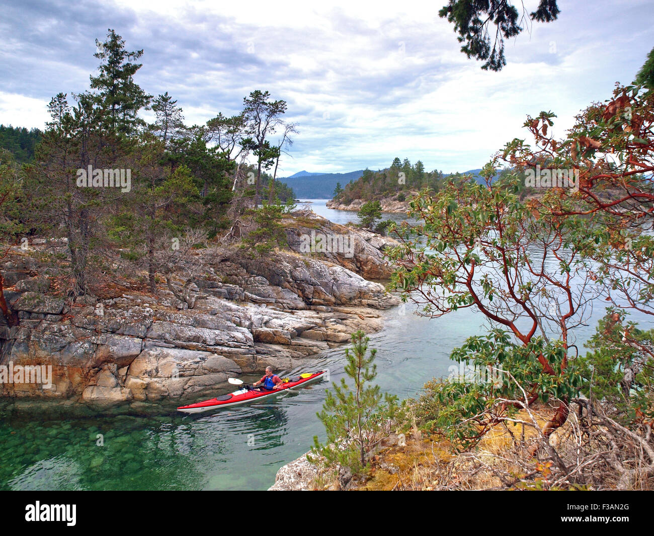 sea kayaking amongst the Curme Islands in Desolation Sound, British Columbia - Stock Image