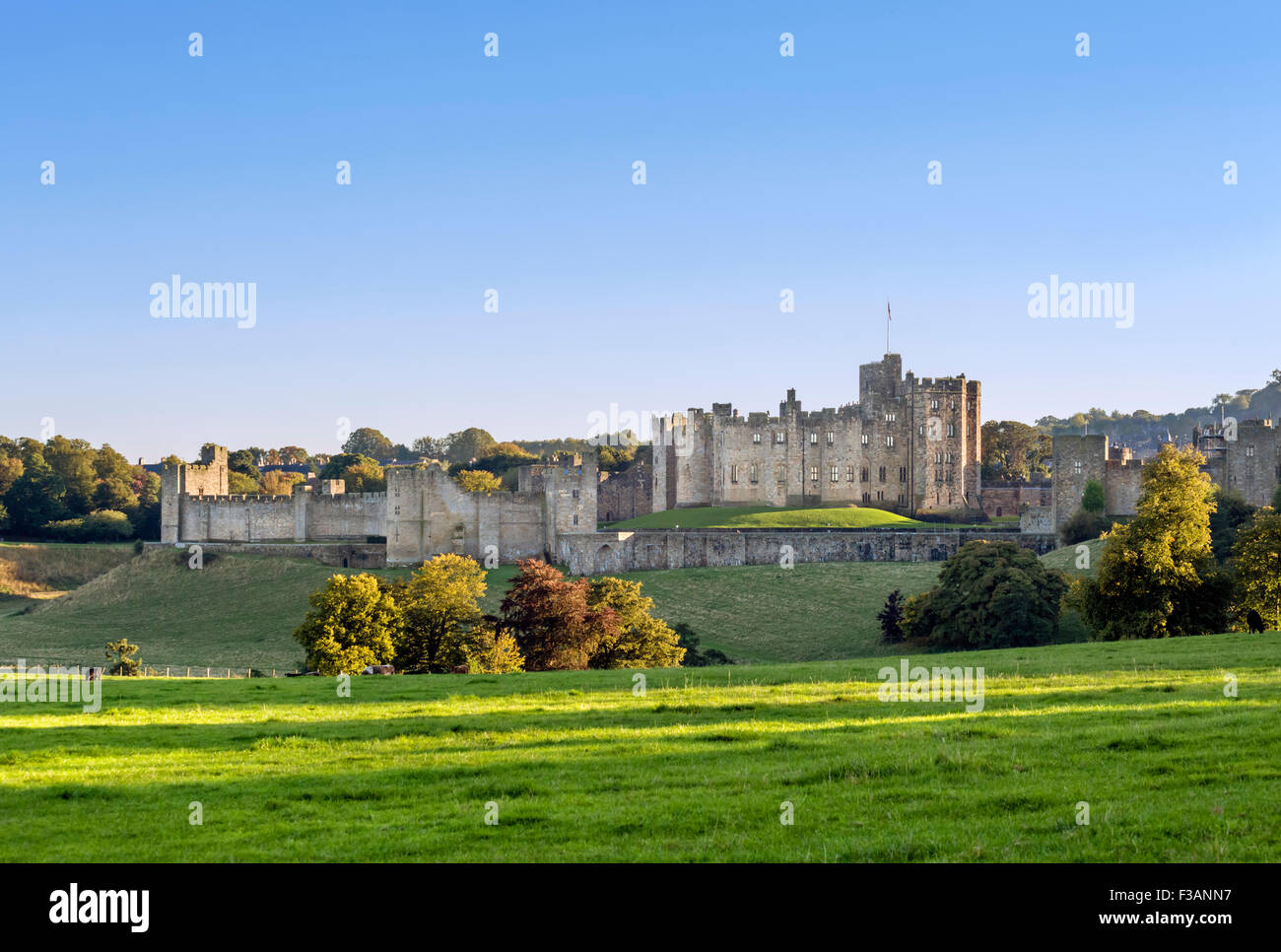 Alnwick Castle in the late afternoon autumn sunshine, Alnwick, Northumberland, England, UK - Stock Image