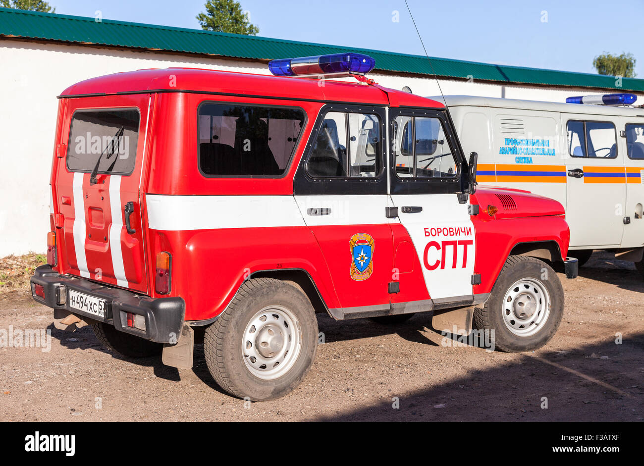 Rescue car parked up in the street. Text on russian: 'Professional emergency rescue service' - Stock Image