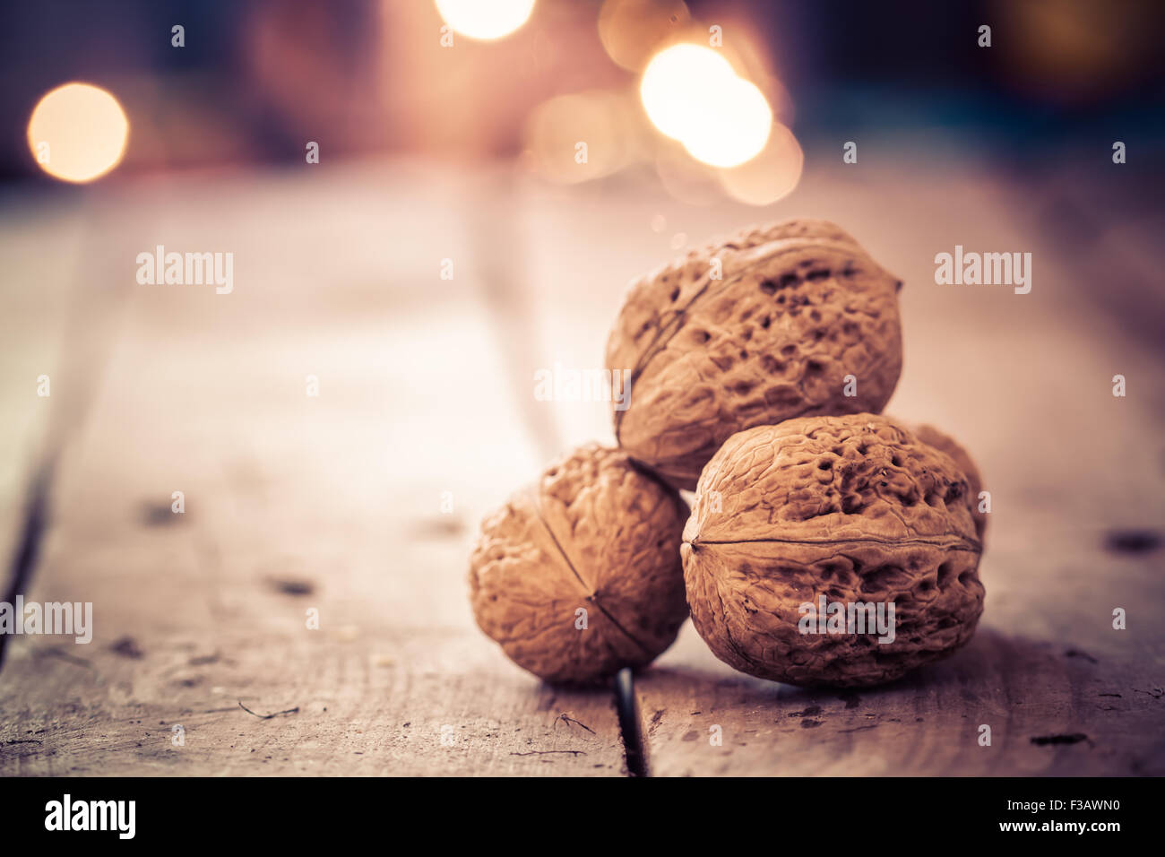 Walnuts on an old wooden table. Christmas background. Stock Photo