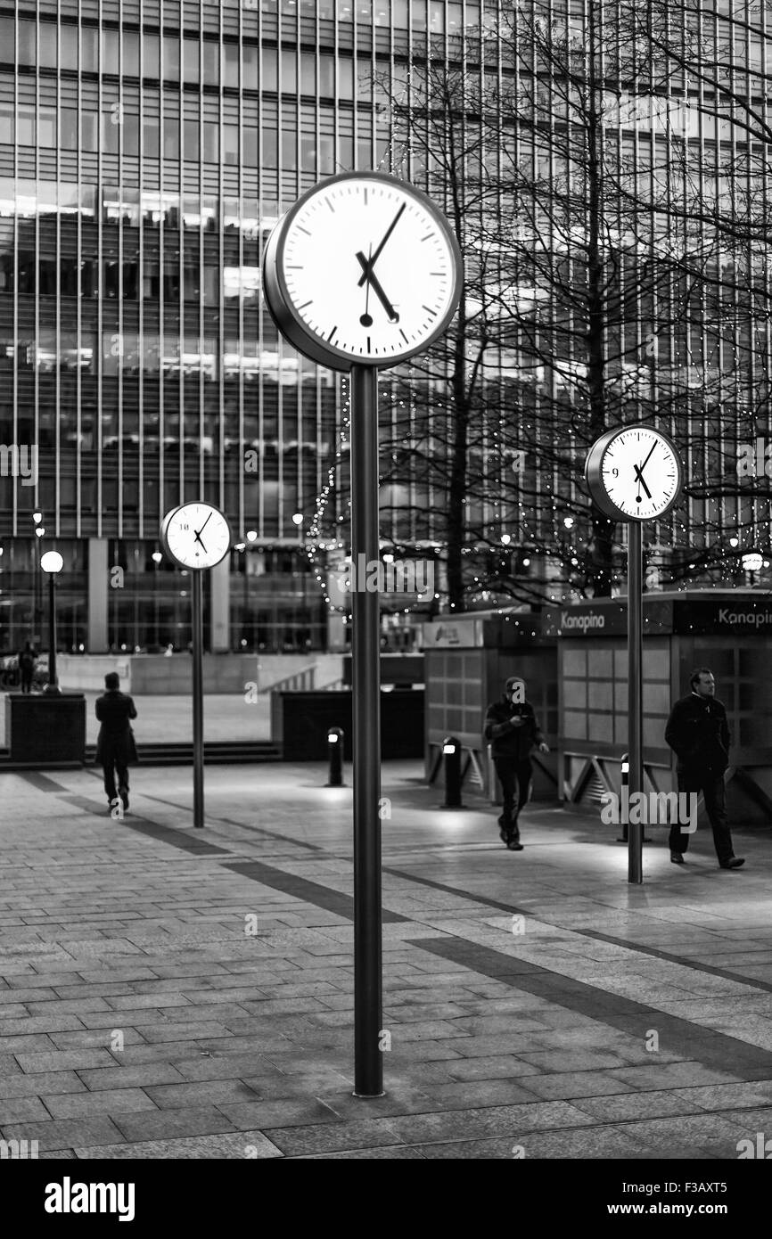 Clocks by Canary Wharf, London: Time Is Money - Stock Image