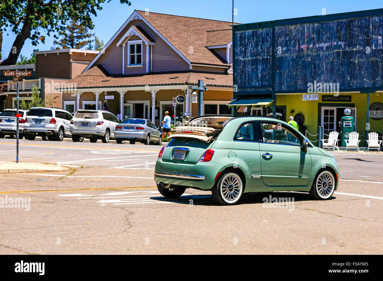 a fiat 500 convertible with white wall tires resembling the original