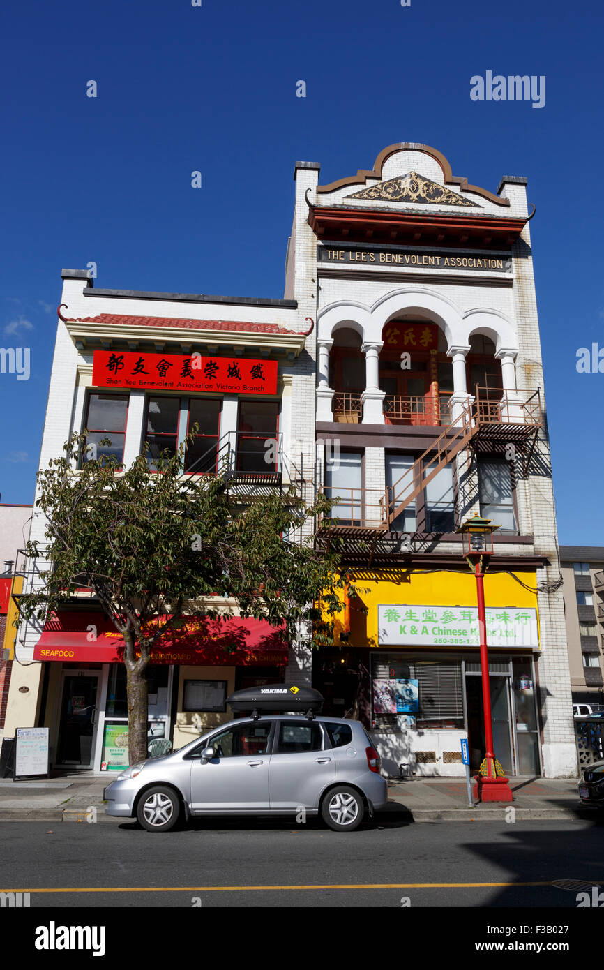 Parked car outside Lee's Benevolent Association building Fisgard Street Chinatown Victoria Vancouver Island - Stock Image