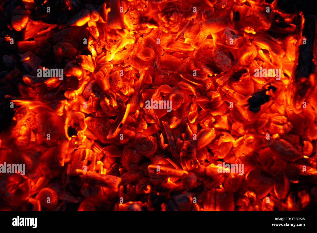 Smoldering charcoal. It is bright and hot. - Stock Image