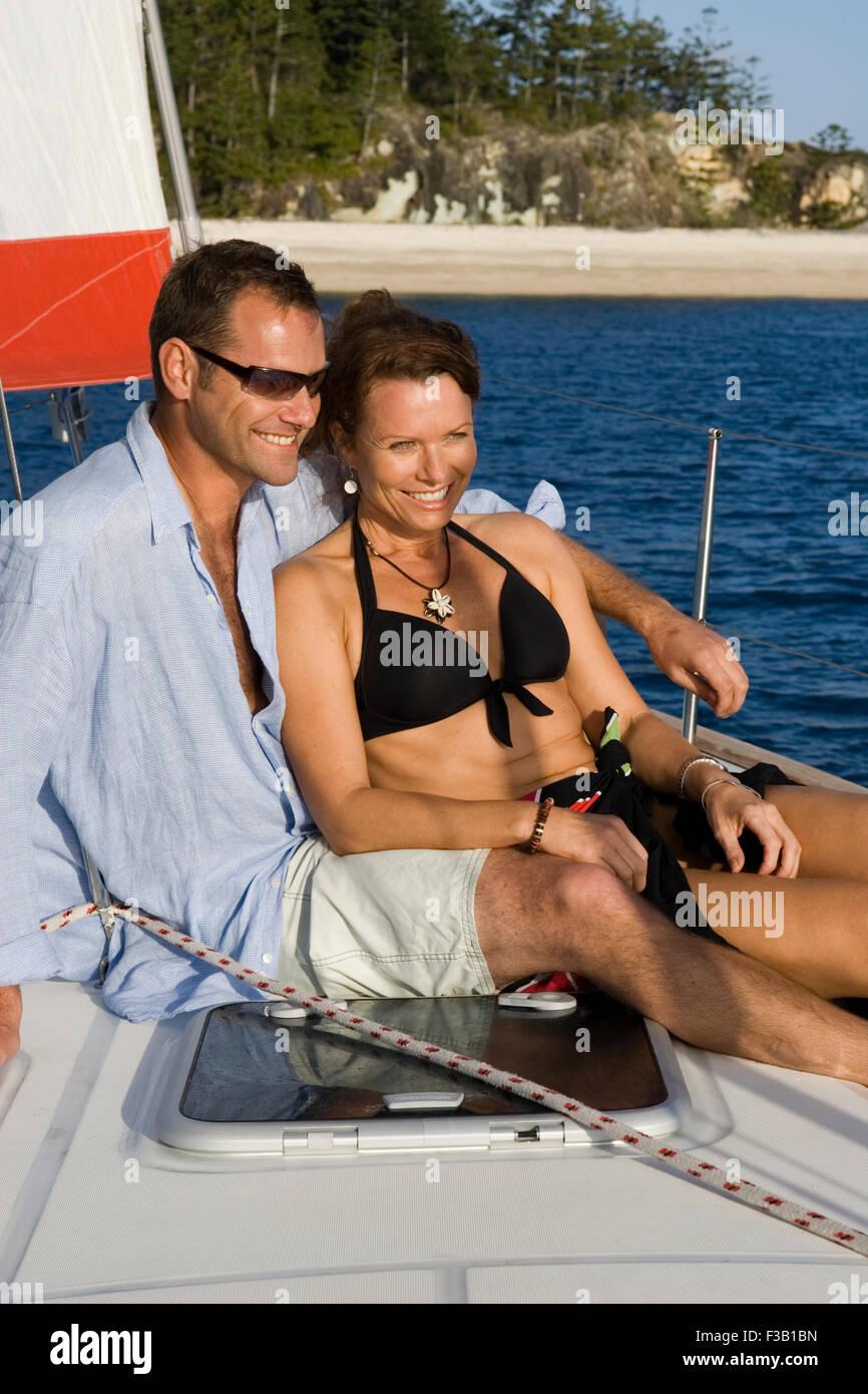 Loving couple enjoying an evenings sail - Stock Image