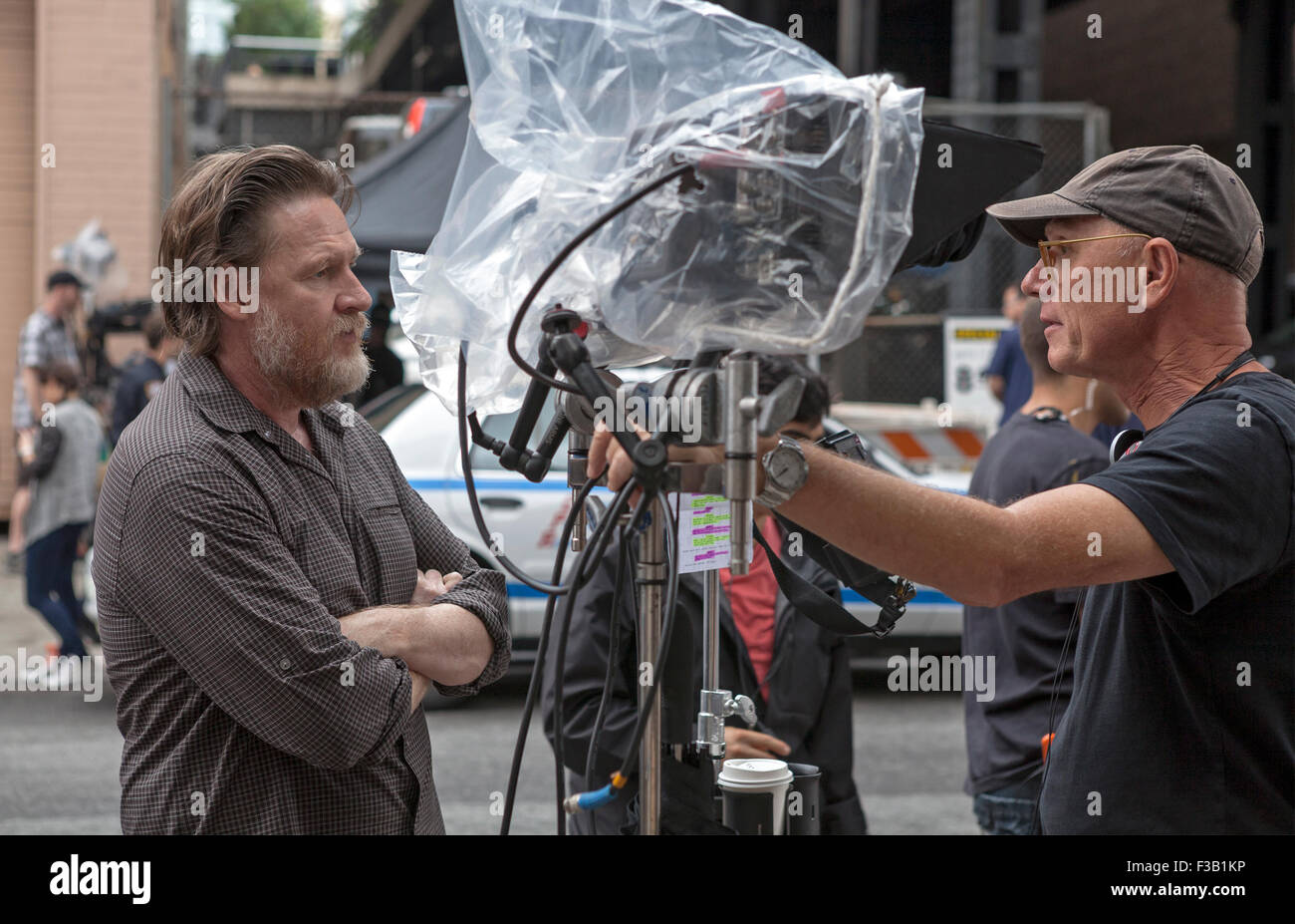 Actor Donal Logue and Director Jean de Segonzac  converse during the filming of Law & Order:SVU in New York City. Stock Photo