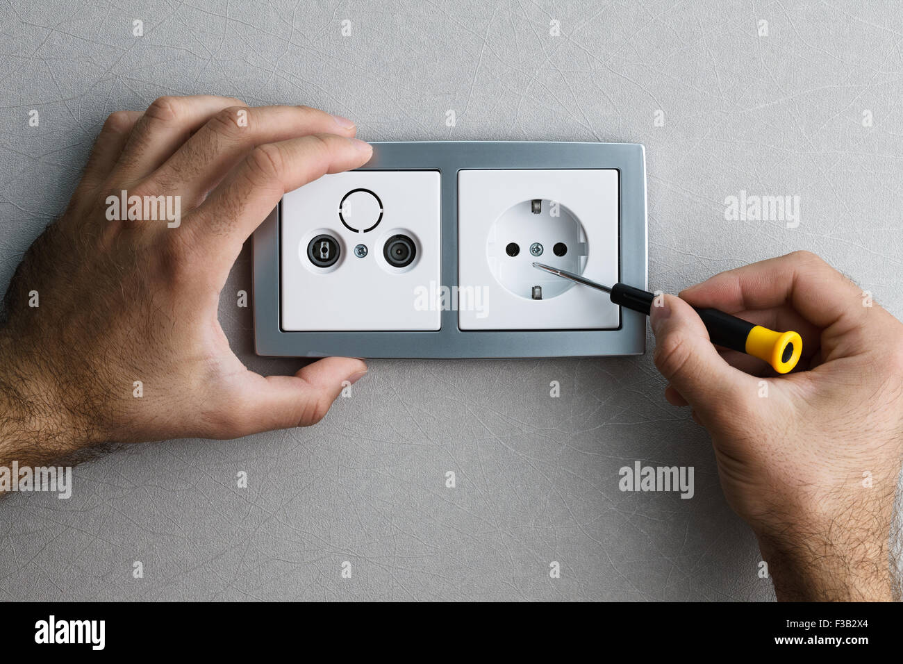 Wall Mounted Socket Stock Photos Images Wiring A Single Plug Uk Installing Silver Ac Power With Screwdriver On Grey