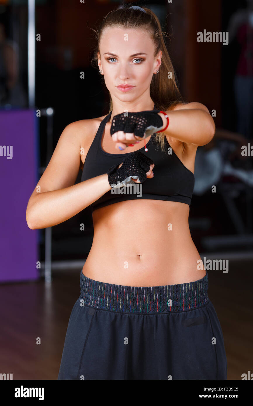 56e0b3a3e2340 Beautiful fitness girl, wearing in black top and breeches, standing on the  boxing pose