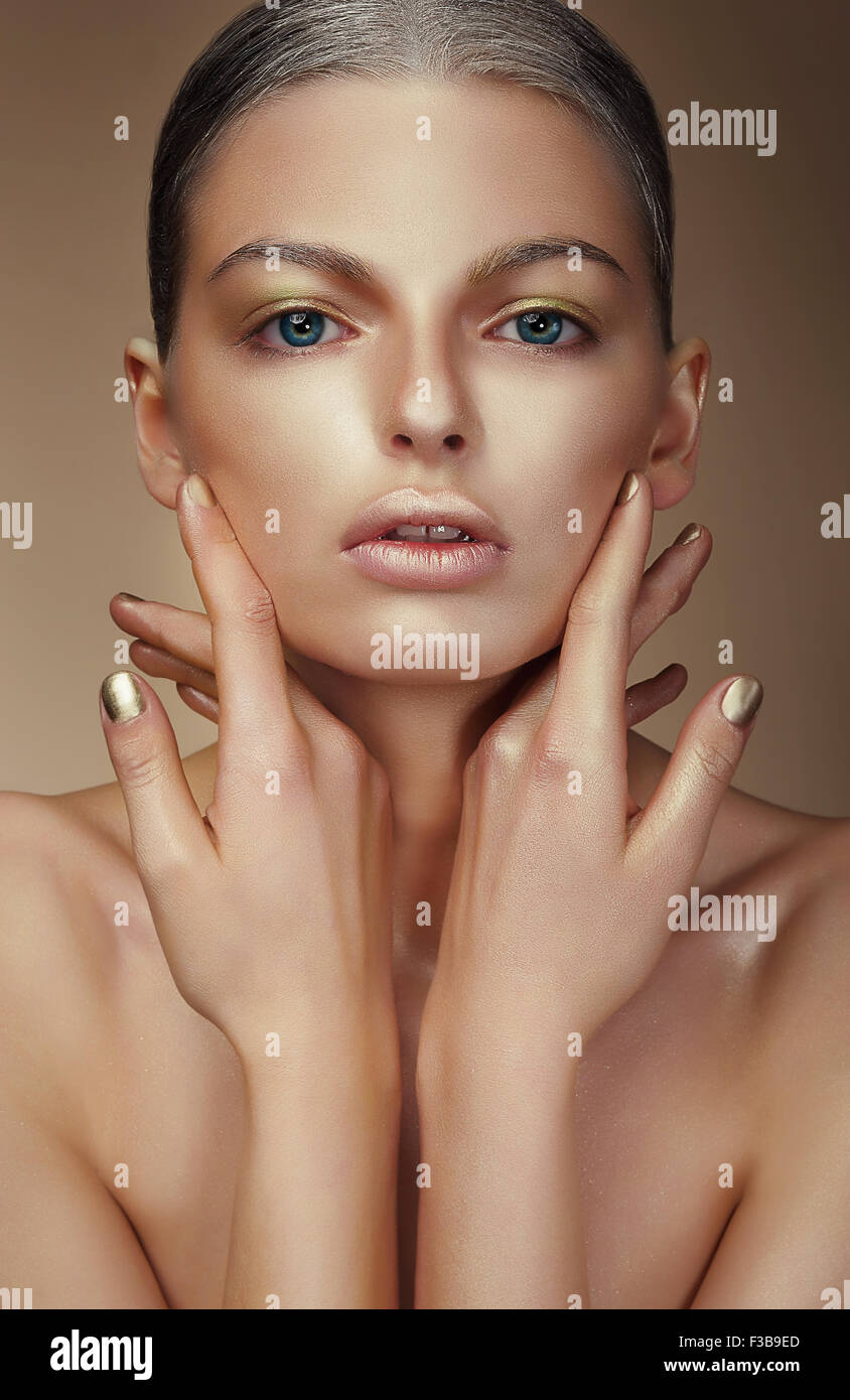 Vogue Style. Young Woman with Bronzed Skin - Stock Image