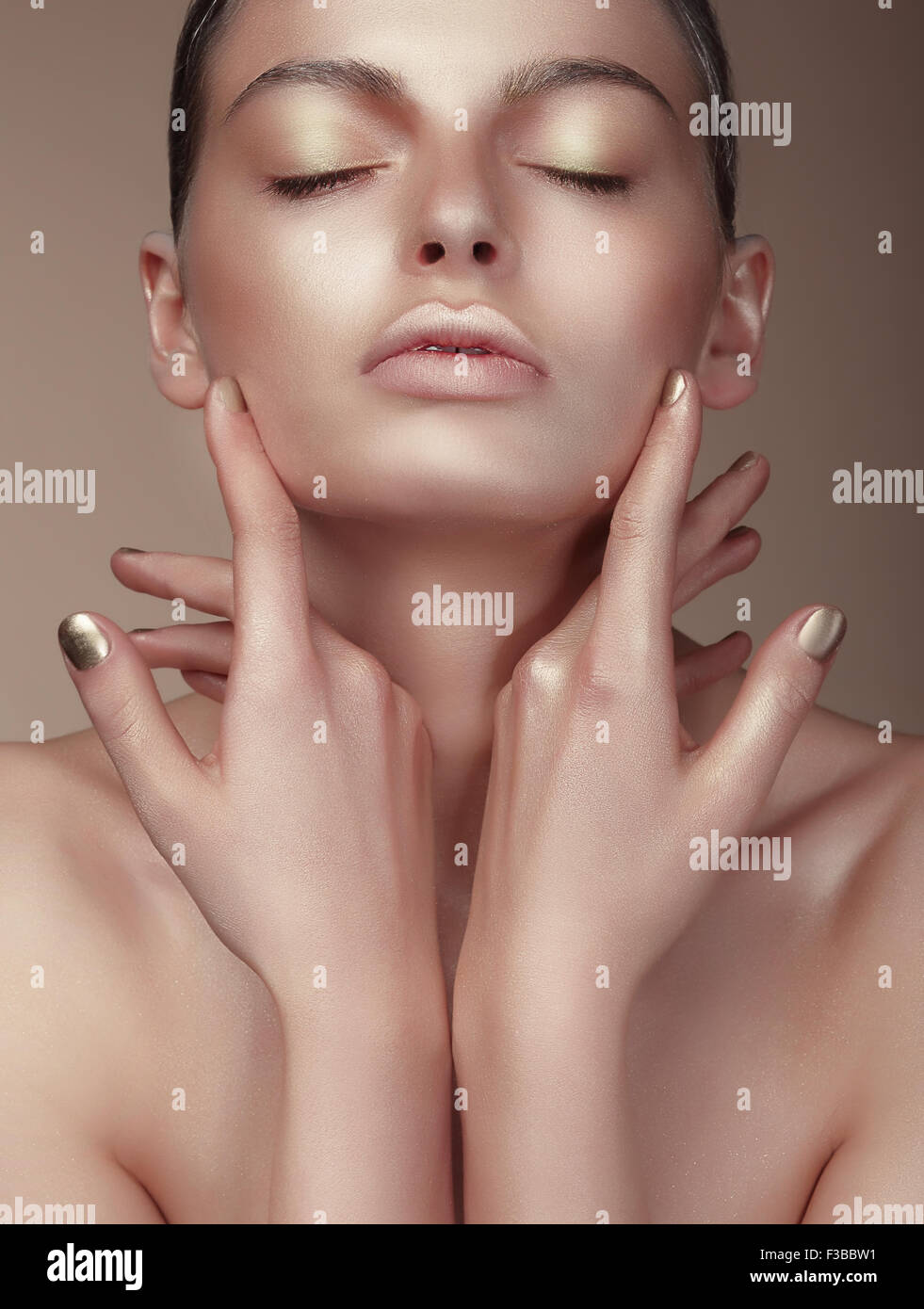 Portrait of Young Cute Woman with Bronzed Skin - Stock Image