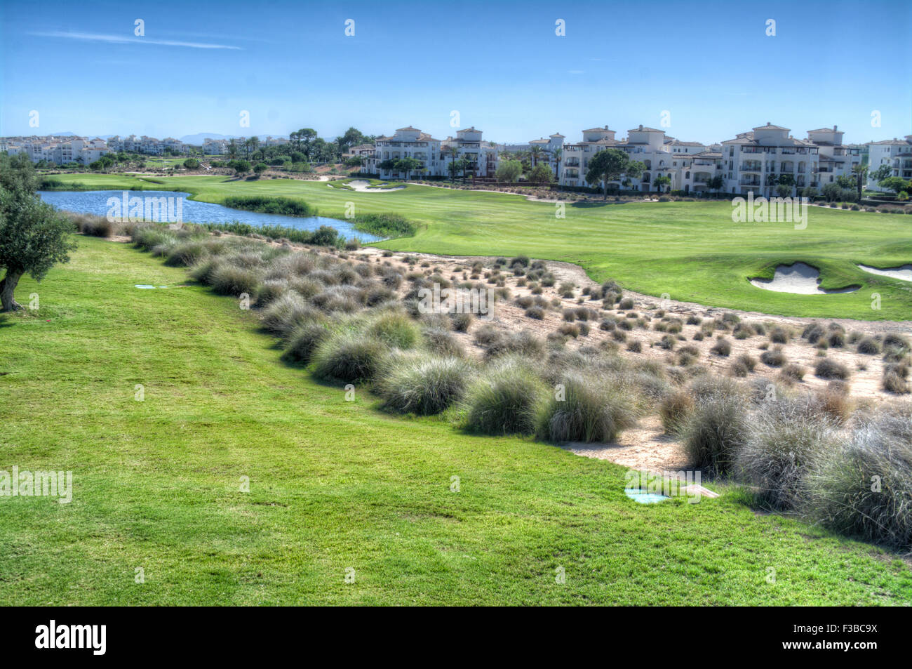 HDR view over the 4th Fairway of the Golf Course at Hacienda Riquelme Golf Resort, Murcia, Spain - Stock Image
