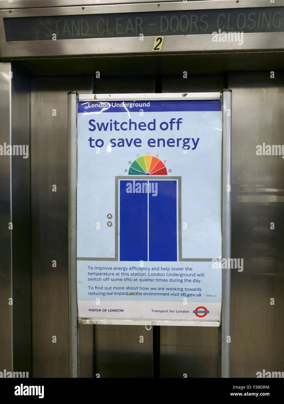 Underground passenger lift switched off outside of rush hour to save energy, London - Stock Image