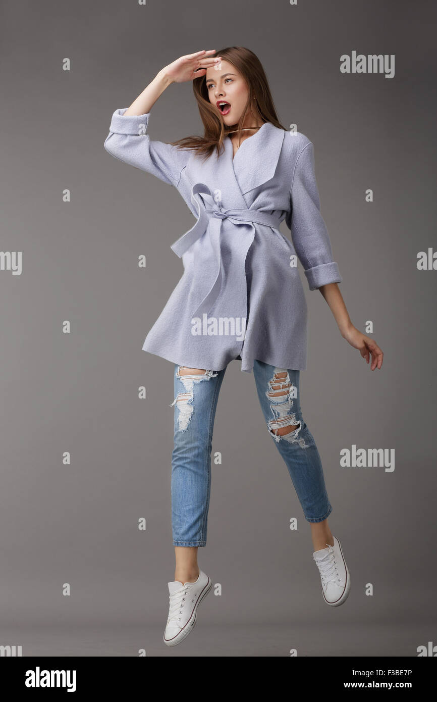 Emotional Young Woman in Outer Garments - Stock Image