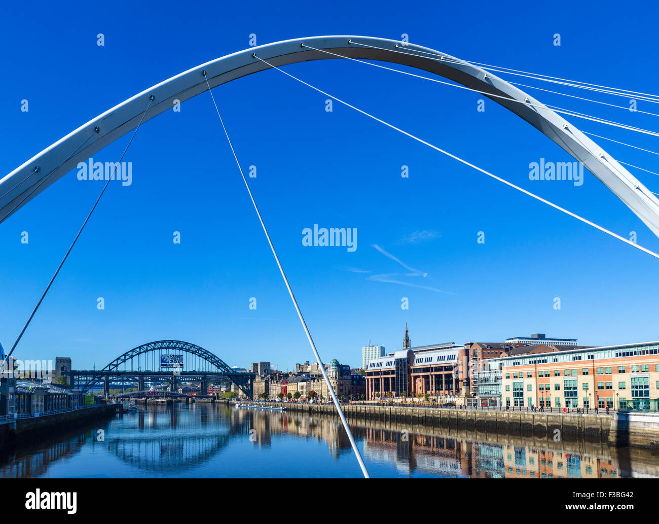 The River Tyne looking towards Newcastle and the Tyne Bridge from the Gateshead Millennium Bridge, Newcastle upon - Stock Image