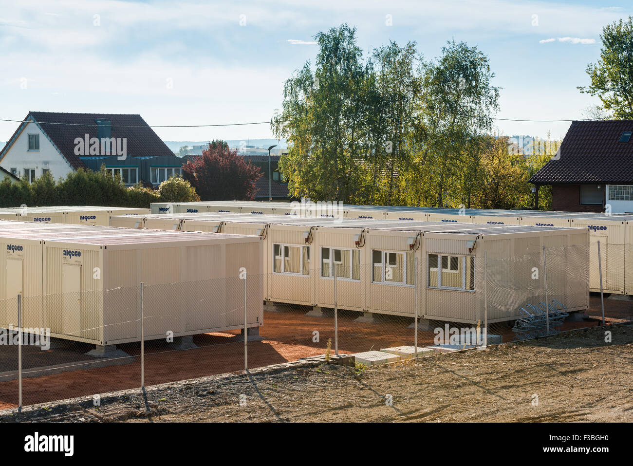 Scharnhausen, Germany - October 3, 2015: A temporary container city is set up on a former tennis ground in order - Stock Image
