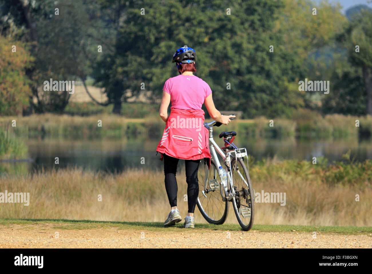 Richmond Park, SW London. 4th October 2015. A cyclist enjoys another day of sunshine in South East England with - Stock Image