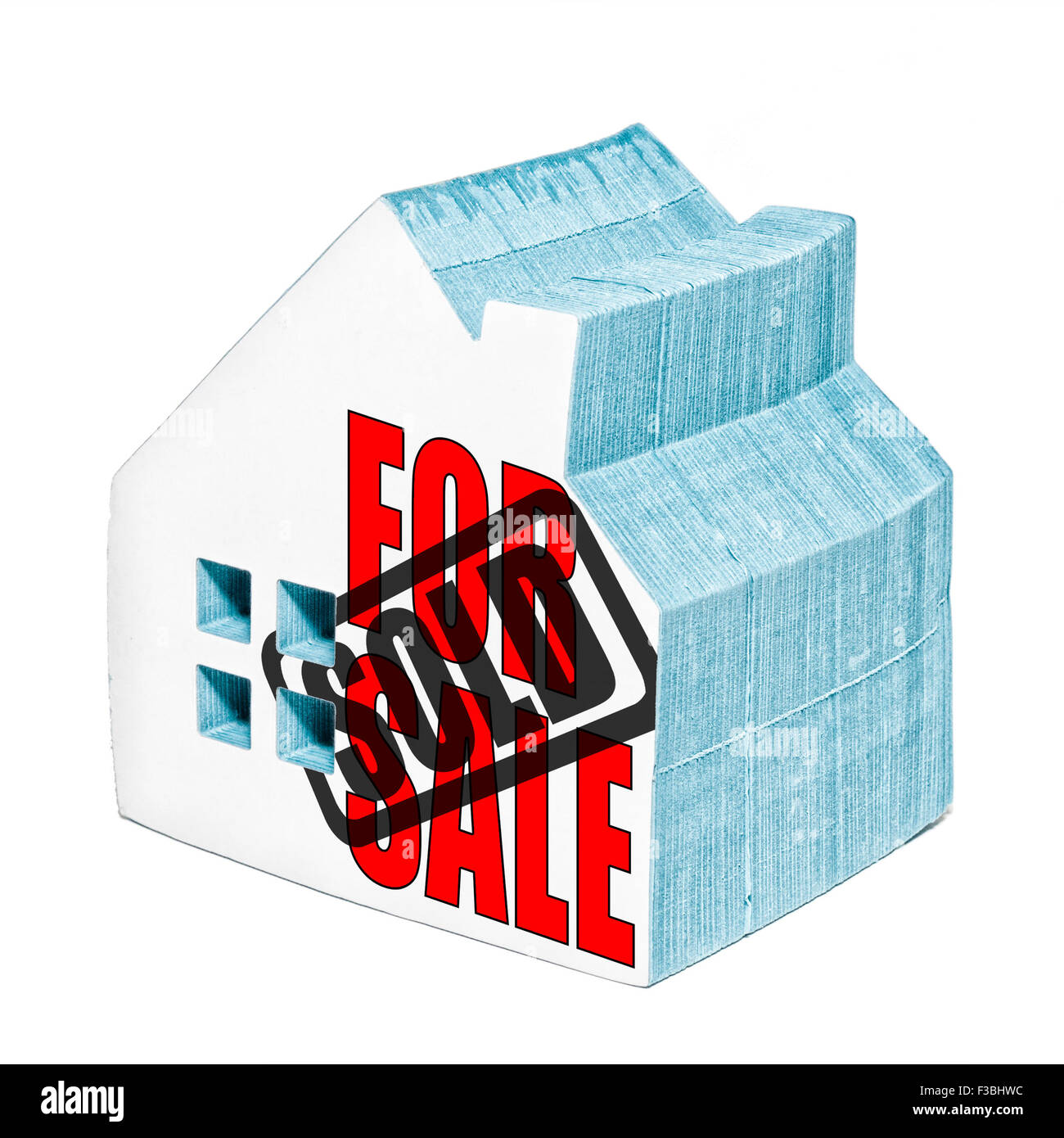 House for sale is sold concept made from a house shaped post it notepad. - Stock Image